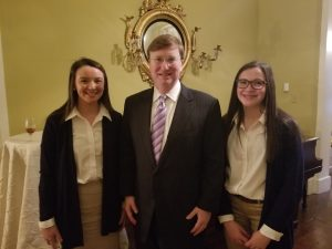 Marianna and Ella visiting with Governor Tate Reeves.
